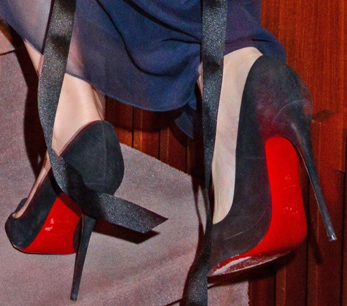 Emma Watson's feet in red-soled Christian Louboutin pumps