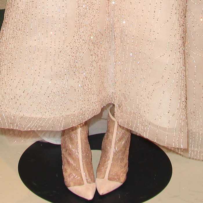 Emmy Rossum'snude lace booties from Monique Lhuillier