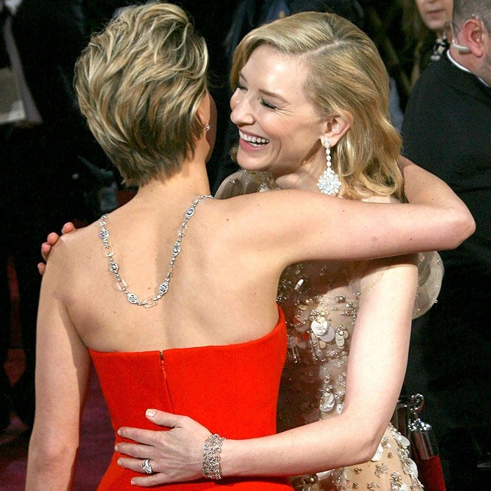 Jennifer Lawrence and Cate Blanchett greeting and hugging each other at the 86th Annual Academy Awards held at Dolby Theatre in Hollywood, California, on March 2, 2014