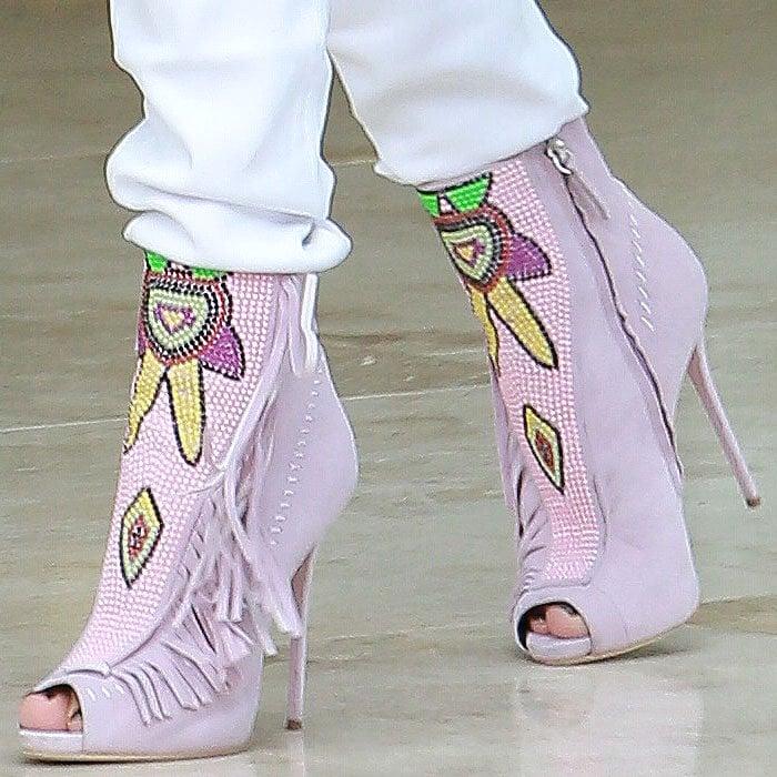 Jennifer Lopez's feet in Mayan-inspired pink beaded Giuseppe Zanotti open-toed booties