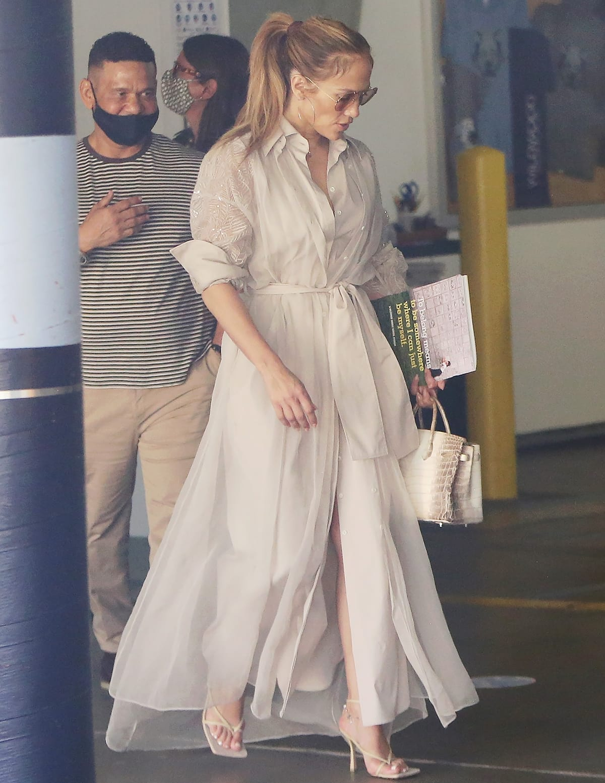 Jennifer Lopez wore a semi-sheer beige Brunello Cucinelli dress and Bottega Veneta Dream sandals