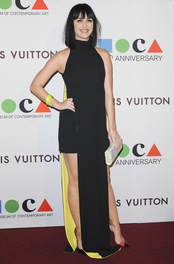 Katy Pery accessorized with a couple of neon yellow bands to match the dress