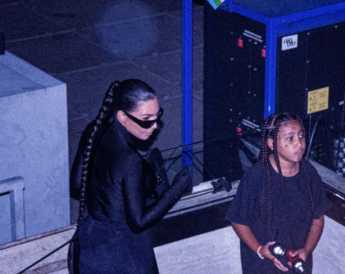 Kim Kardashian in a figure-hugging black Balenciaga outfit to show her support for Kanye West at his album launch party
