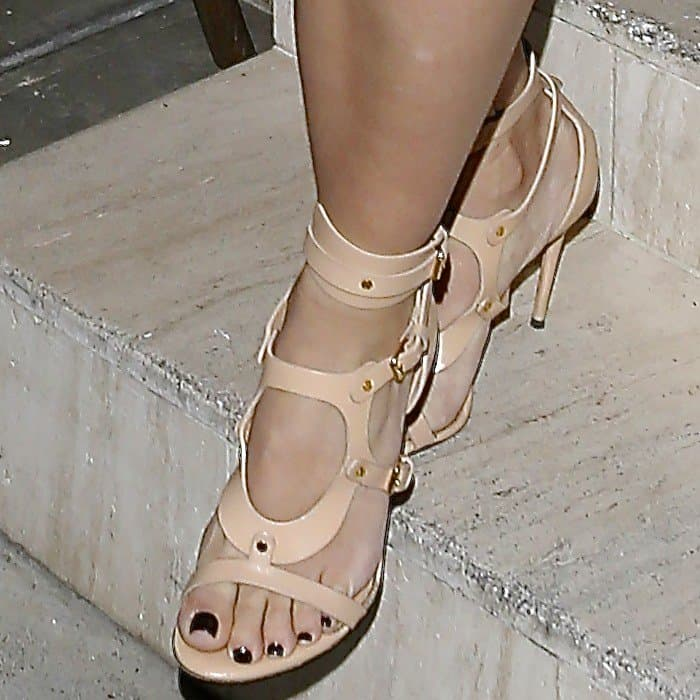 Kim Kardashian wearing Tom Ford triple-buckle sandals