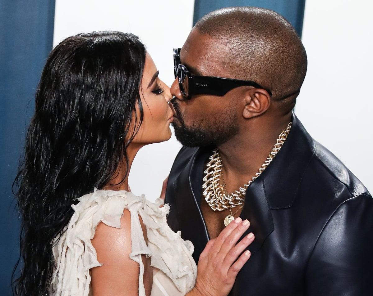 Kim Kardashian West and Kanye West kissing at the 2020 Vanity Fair Oscar Party