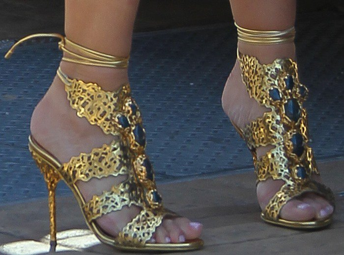 Kim Kardashian in Sergio Rossi filigree sandals in gold