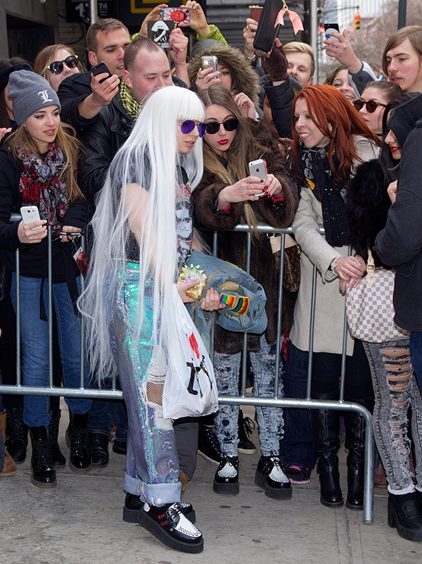 Lady Gaga was seen posing with her fans and signing autographs outside her Midtown hotel