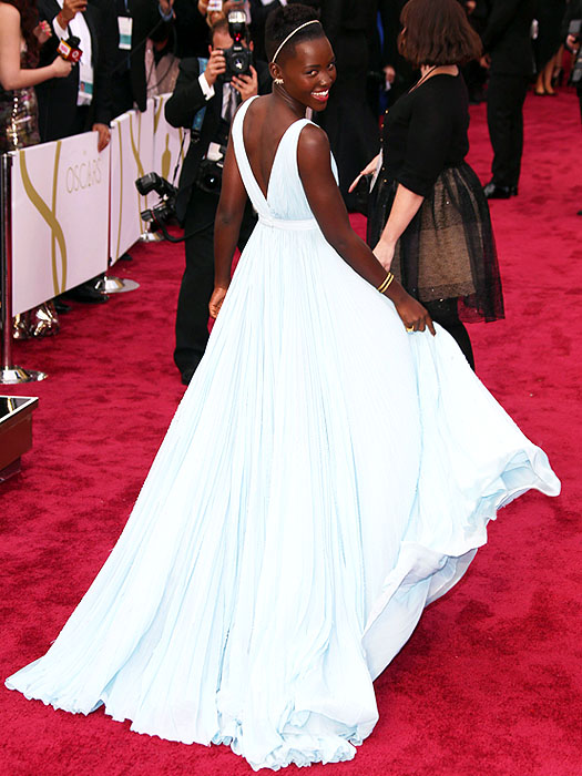 Lupita was clearly having fun with her Prada gown on the red carpet.