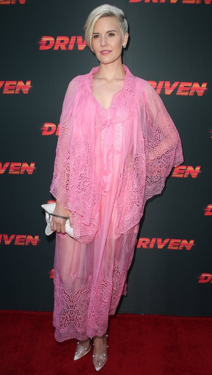 Maggie Grace in a pink sheer dress lace dress at the premiere of Driven