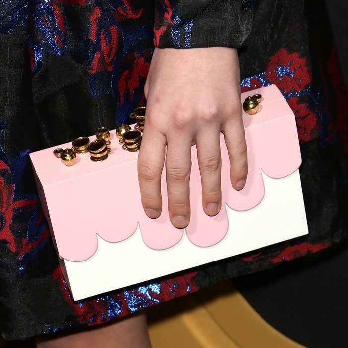 Malina Weissman's quirky white and pink box clutch