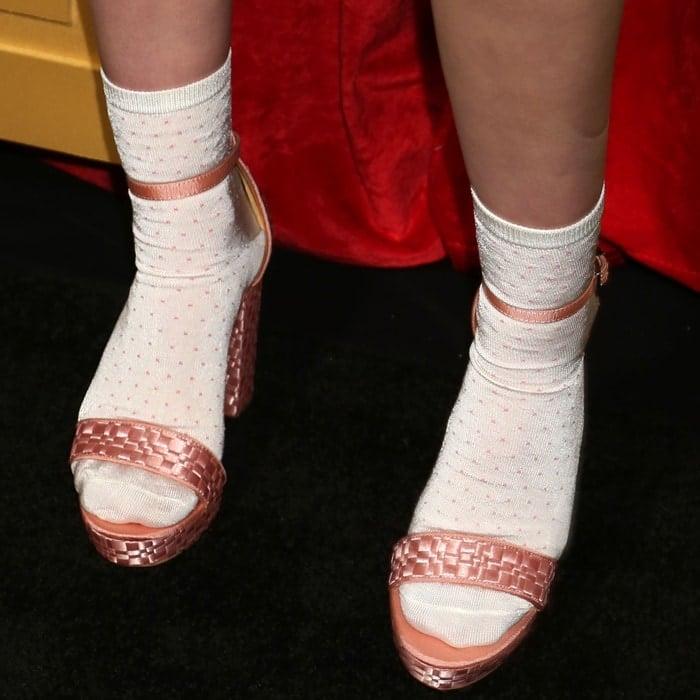a005e0d63a9 Malina Weissman s pink platform sandals and white socks.