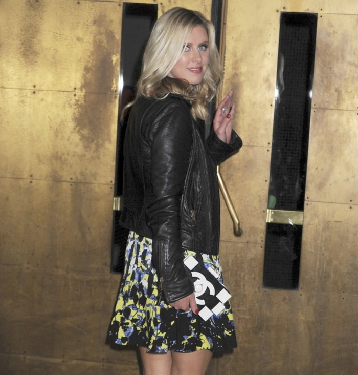 Nicky Hilton was equal parts pretty and sassy in a black leather biker jacket over a printed dress in varying colors of yellow, blue, black, and white from Peter Pilotto for Target