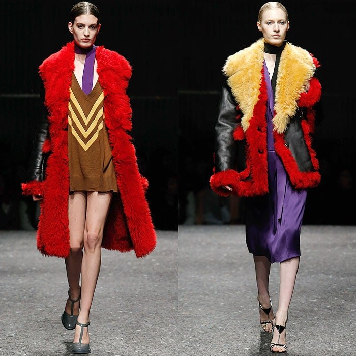 Rihanna's chevron-striped sweater dress and black-red-and-yellow shearing coat on the Prada Fall 2014 catwalk presented during Milan Fashion Week Womenswear Fall/Winter 2014–2015 in Milan, Italy, on February 20, 2014