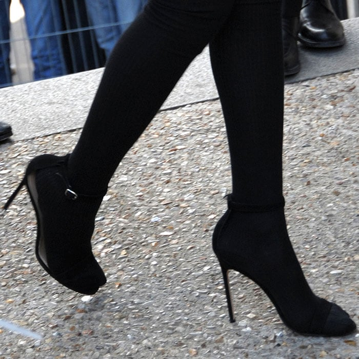 Rihanna wearing black suede ankle strap sandals