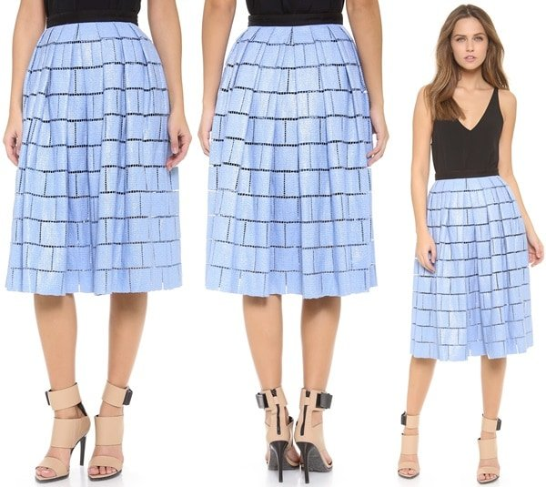 A slick coating gives this Tibi skirt a glossy sheen, and pleats accentuate the full silhouette