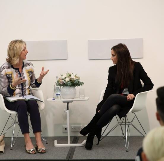 Susie Forbes and Victoria Beckham conversing during a Q&A classroom discussion at the Condé Nast College of Fashion & Design in London, England, on March 12, 2014