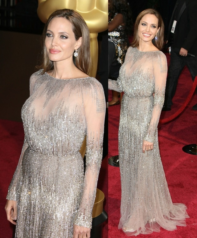 Angelina Jolie finished the frock with dazzling 42-karat diamond drop earrings and smokey-eye makeup to match