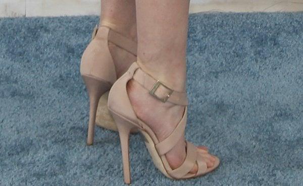 "Anna Kendrick's feet innude ""Xenia"" sandals from Jimmy Choo"