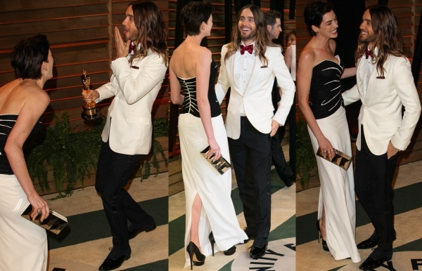Jared Leto photobombing and sharing a laugh with Anne Hathaway at the 2014 Vanity Fair Oscar Party held at Sunset Plaza in West Hollywood, California, on March 2, 2014