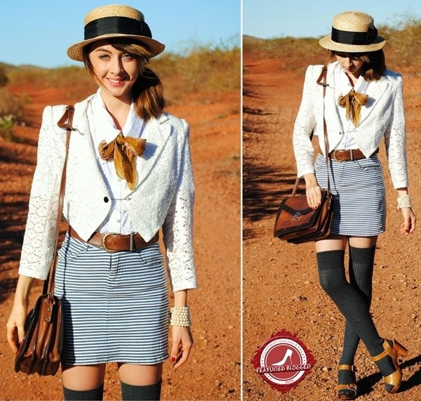 Autilia Antonuccigiving her tailored outfit a casual spin by pairing it with gray over-the-knee socks and brown platform sandals