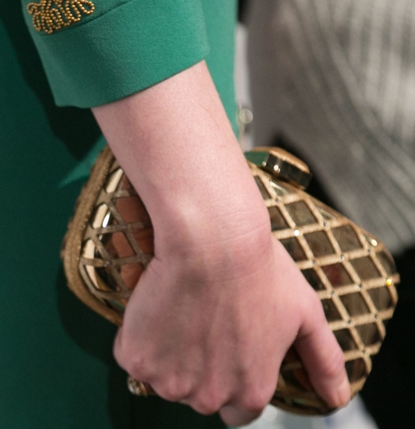 Christina Hendricks toted a gold clutch at the 'Mad Men' presentation