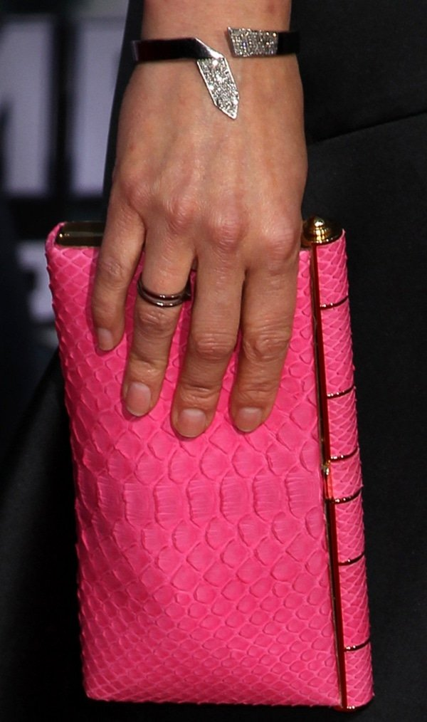 Cobie Smulders showing off her jewelry and pink clutch