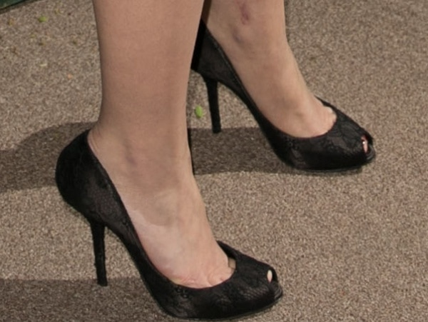 Dianna Agron wearing black lace peep-toe pumps