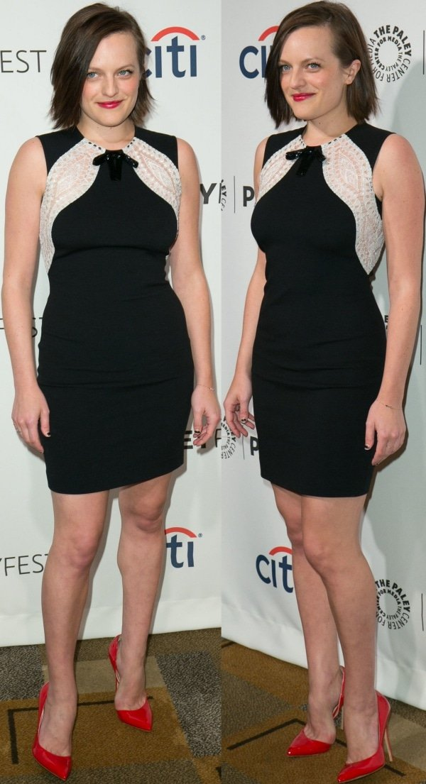 Elisabeth Moss opted for a sexy yet classy look in a sleeveless black Emilio Pucci dress with white lace panels