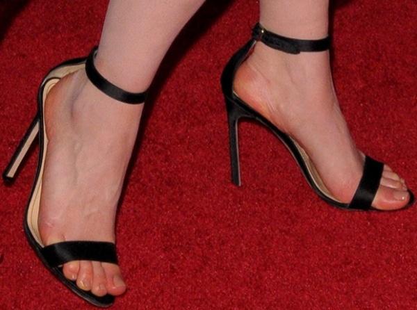 Emilia Clarke wearing black ankle-strap heels from Manolo Blahnik