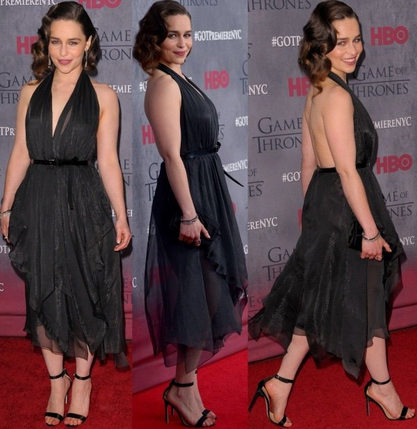 Emilia Clarke showed off her smooth shoulders and toned back in a black belted halter handkerchief dress from Donna Karan's Fall 2014 collection