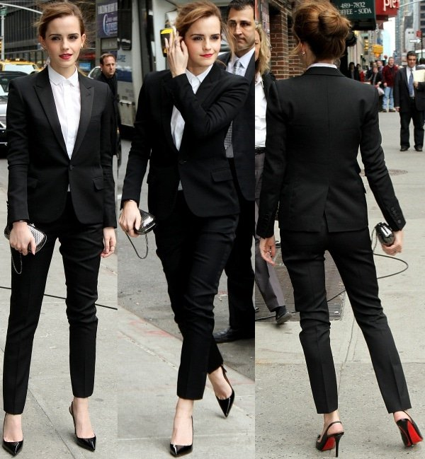 Emma Watson ina crisp white cotton poplin shirt, which was buttoned at the collar and tucked into her skinny virgin wool tuxedo pants