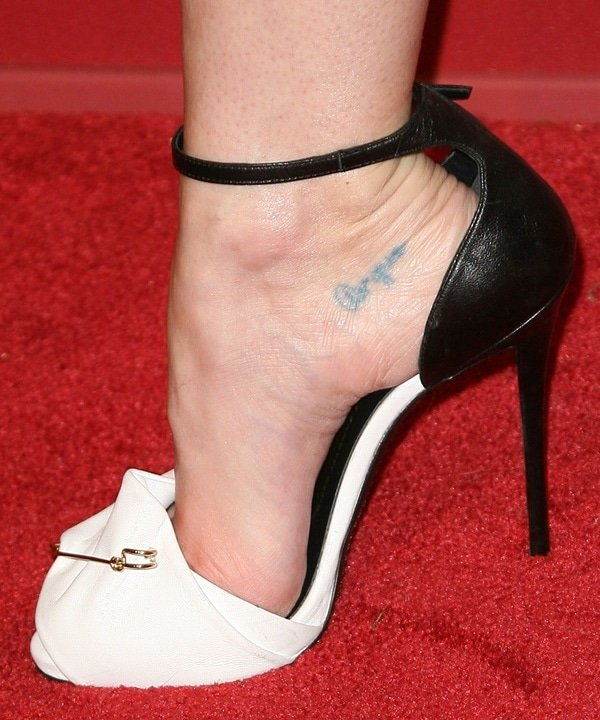 Jaime King has a Spanish foot tattoo on the inner side of her right heel