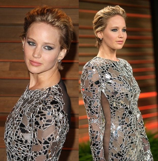 Jennifer Lawrence getting a little risque by wearing a Tom Ford mirror-detailed party dress at the Vanity Fair Oscar Party held at Sunset Plaza in West Hollywood on March 2, 2014