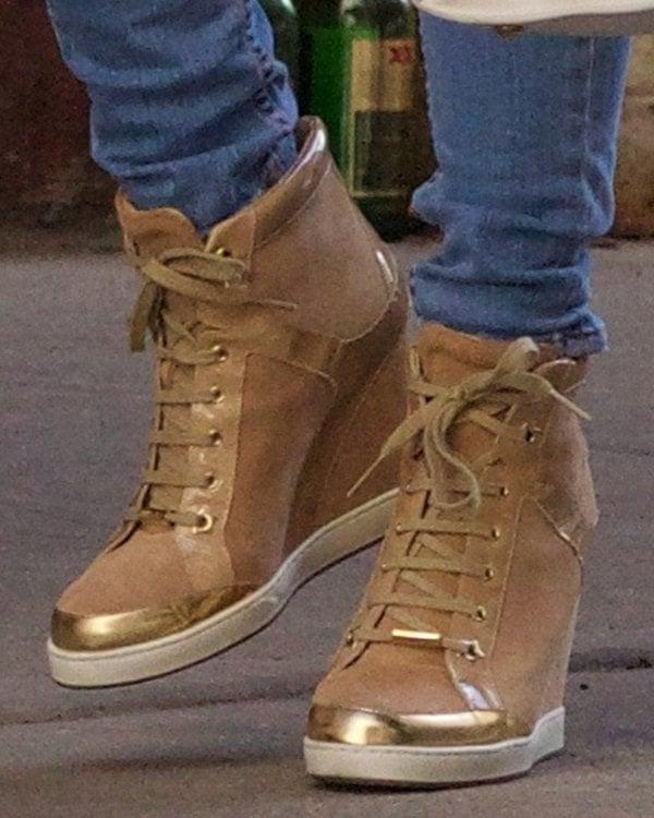 Jessie J wearingJimmy Choo gold-detailed sneakers
