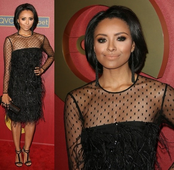 Kat Graham in a flapper-inspired dress fully decorated with feathers