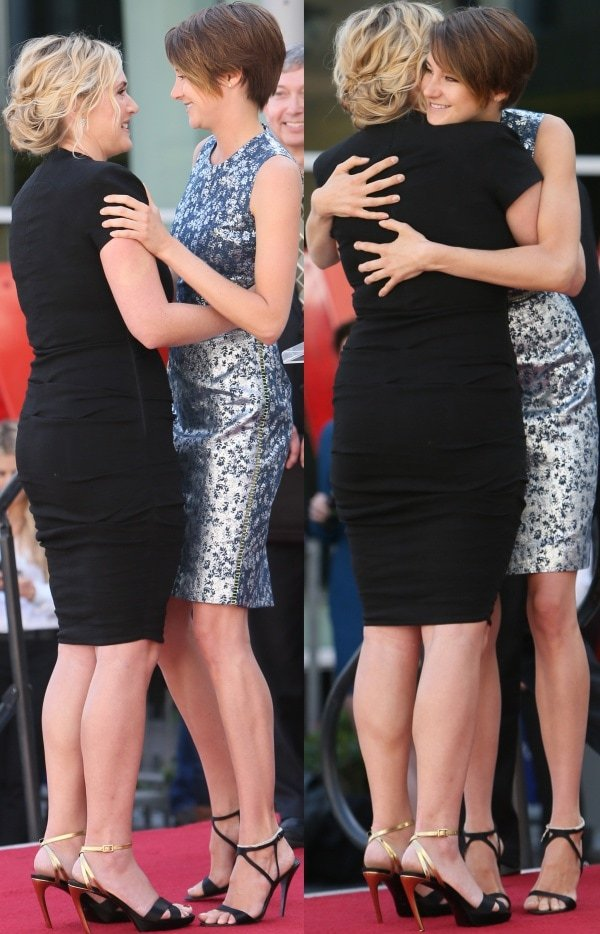 Kate Winslet getting some love and support from Shailene Woodley