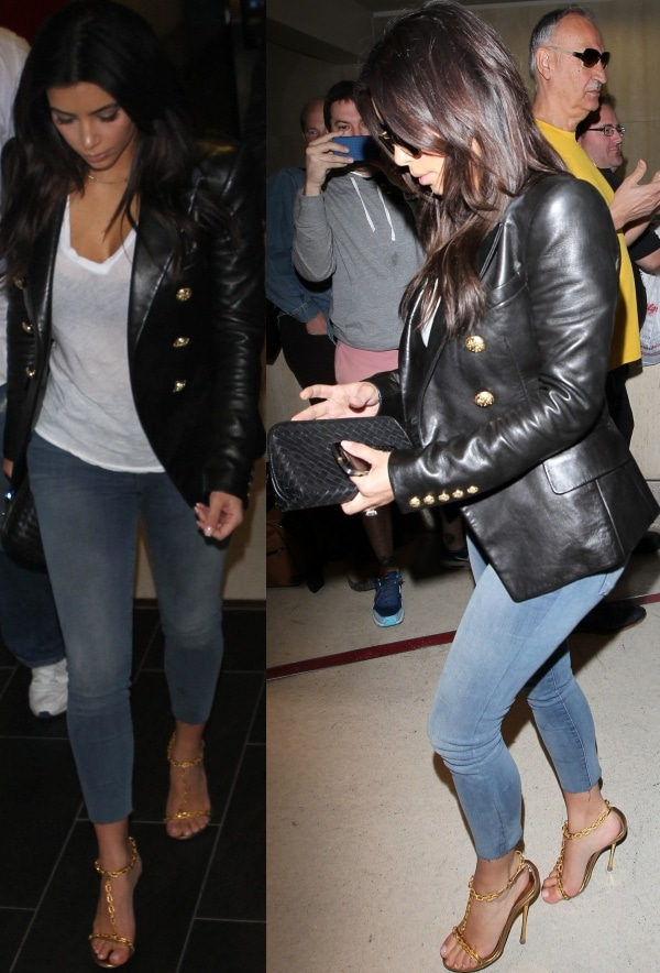 Kim Kardashian in a black double-breasted leather blazer from Balmain over a white shirt and denim jeans