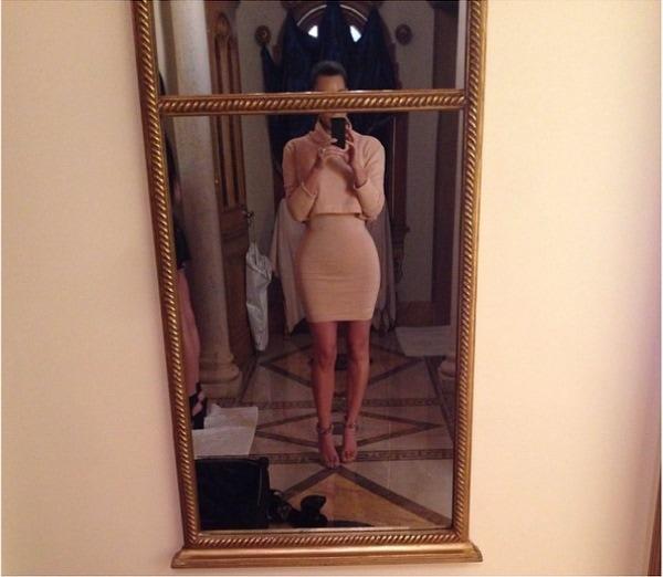 "Kim Kardashian's Instagram photo with the caption, ""Today's Look- #KardashianKollectionCroppedTurtleneck #VintageAlaiaDress #AlaiaHeels"" - posted on March 13, 2014"