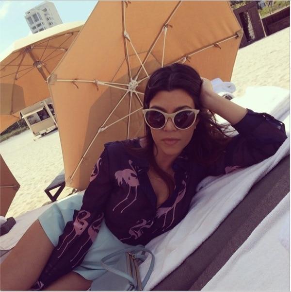 "Kourtney Kardashian's Instagram photo with the caption, ""Beach life. #miami"" - posted on March 13, 2014"