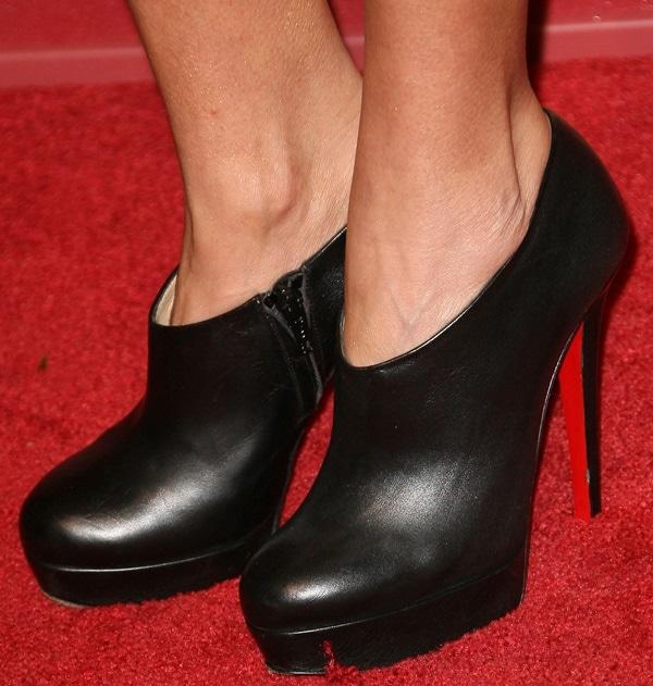 Kristin Chenoweth wearing classic Christian Louboutin booties