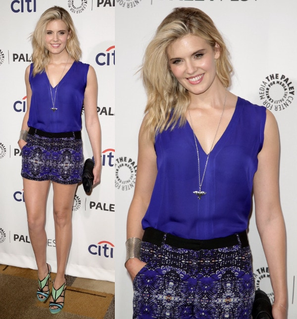 Maggie Grace wearing a deep blue tank and a matching pair of printed shorts