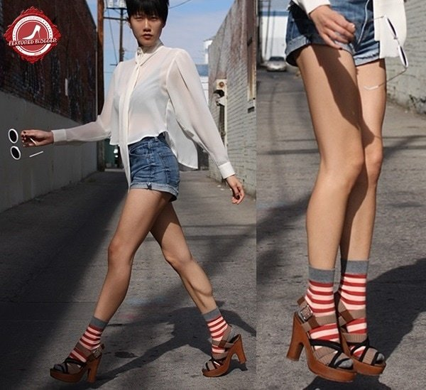 Paanie Pho sporting platform sandals and contrasting striped red socks