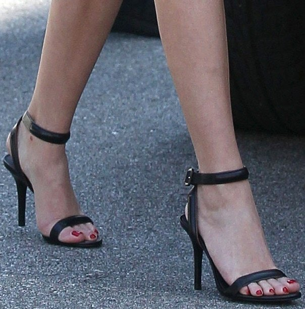 Reese Witherspoon's pedicured feet in ankle-strap sandals