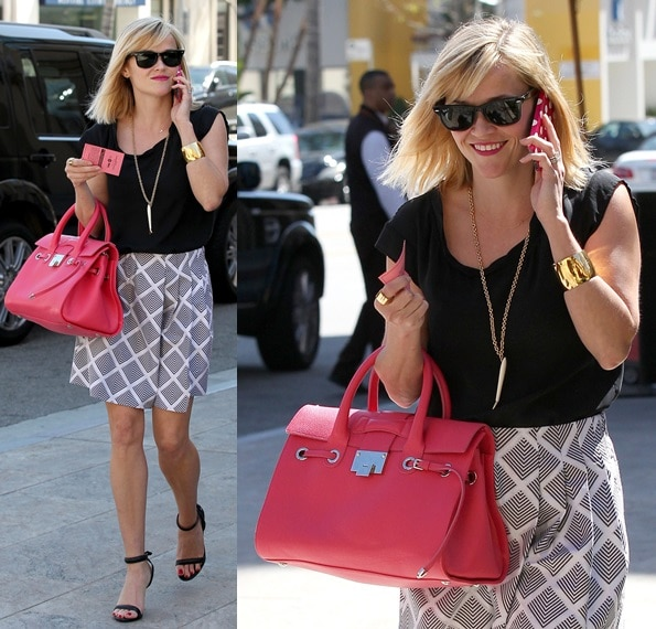 Reese Witherspoon flaunting her latest pair of strappies — classic black open-toe heels with padded straps
