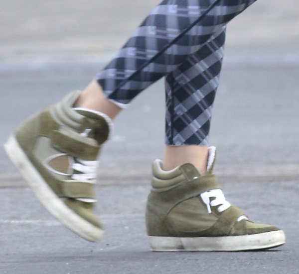 Sarah Jessica Parker in printed pants and olive green wedge sneakers