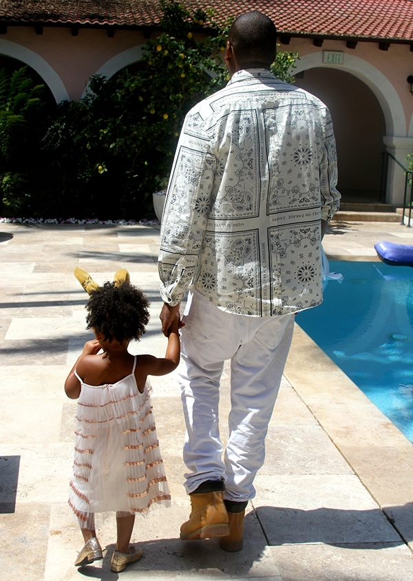 Blue holding her dad's hands