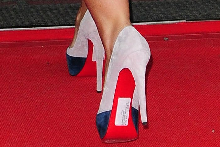 The red bottoms all the more highlighted British TV presenter Coleen Rooney's grave fashion faux pas