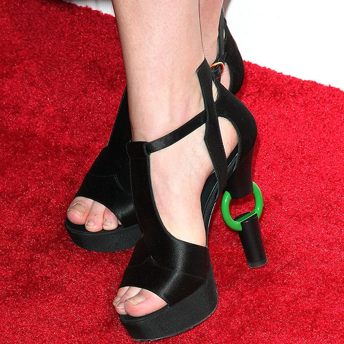 Dree Hemingway shows off her feet in black satin ring-heel sandals