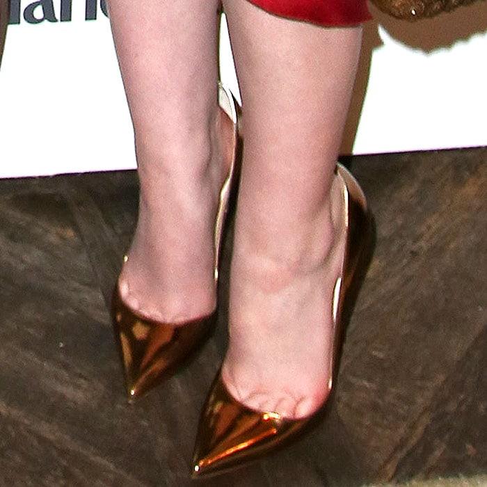 Elle Fanning wearing Chrisian Louboutin So Kate heels