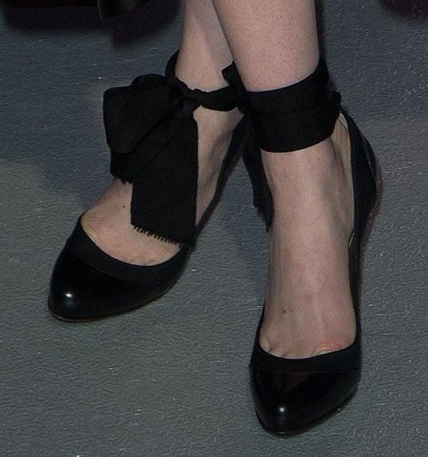 Emma Stone wearing Lanvin cap-toe ankle-strap pumps
